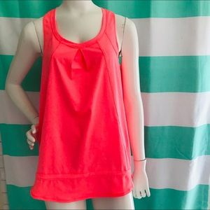 NWT bright coral workout top. Toggle bottom.